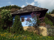 Countryside landscape, an old peasant house. Sunny spring countryside landscape, an old peasant house surrounded by flowering vegetation stock photos