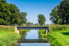 Countryside landscape railroad steel bridge over water canal Stock Photos