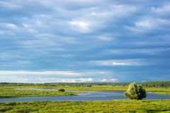 Countryside landscape. A river near the village Stock Image
