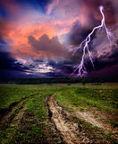 Countryside landscape with road. Countryside landscape with dirt road and lightning bolt royalty free stock image
