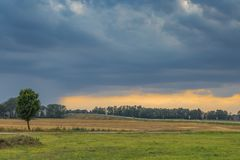 Countryside landscape on a stormy summer evening. Somewhere in Lithuania Royalty Free Stock Photo