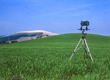 Countryside landscape with technical photo camera Royalty Free Stock Photography