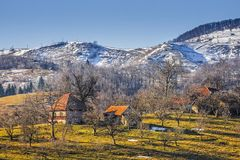 Countryside landscape. With traditional Romanian mountainous hamlet and snow covered hills in Moeciu, Brasov county, Trasylvania region, Romania Royalty Free Stock Photos