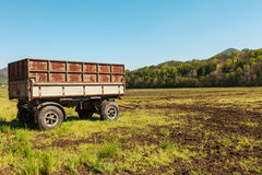 Countryside landscape with wagon for agriculture Stock Photos