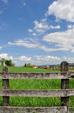 Countryside landscape and wooden fence Stock Photo
