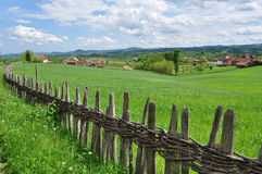 Countryside landscape and wooden fence Royalty Free Stock Photo