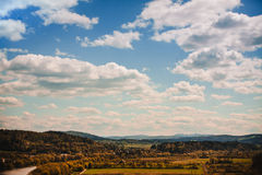 Countryside landskape. With fields, forests and cloudy sky Stock Photo