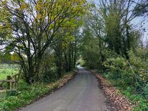 Countryside road in rural Cheshire England United Kingdom. Countryside lane in Cheshire UK Royalty Free Stock Photos