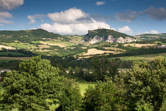 Countryside of le Marche, Italy. Hilly countryside of le Marche, Italy, with view to the fortress of San Leo Royalty Free Stock Photography