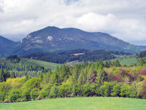 Countryside with Lomy hill near Bobrovnik. Summer view of hill Lomy [also called: Lomne] (alt. 1278 meters) in green forests near Bobrovnik village. This hill is stock image