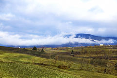 Countryside meadows with fog in the mountain peak Royalty Free Stock Image