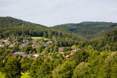 Countryside mountain landscape with houses in village. Beautiful countryside mountain landscape with a little red roof houses in village. Germany, Black forest Stock Image