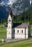 Countryside in the mountains. Church in the mountains, mountain landscape Royalty Free Stock Photos