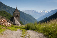 Countryside in the mountains. Church in the mountains, mountain landscape, clock tower stock photos
