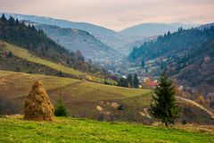 Countryside in mountains on a gloomy day. Lovely countryside in mountains on a gloomy day. village down in the valley. huge ridge in the distance royalty free stock photo