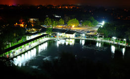 Countryside Night landscape Fishing Pond. Night scenery of rural village and unrecognizable motion blur people fishing beside the fish farm Stock Image