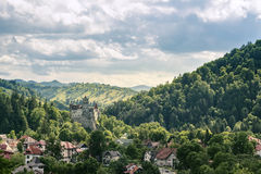 Countryside overlook view of houses and castle over the hills in the summer royalty free stock photo