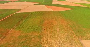 Countryside pattern from air. Countryside pattern with many squares fields seeing from air. Farmland stock video