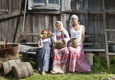 Countryside photograph of a woman with daughters stock image