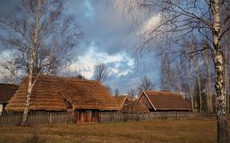 Small wooden cottages in a countryside royalty free stock photos