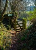 Countryside public footpath with open gate in spring.  royalty free stock image