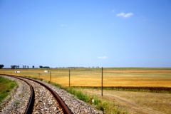 Countryside railway. Railway passing the fields in the countryside Royalty Free Stock Photo
