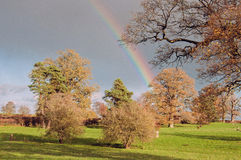 Countryside rainbow over the landscape of England. Stock Photography