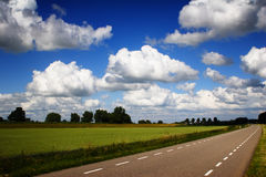 Countryside Road. A small countryside road among fields of crops in the Netherlands stock photos