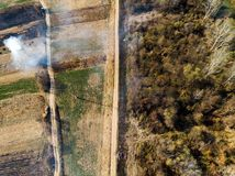 Countryside road and scenery aerial view. Countryside road and agriculture land scenery aerial view, path, landscape, above, farming, lane, empty, fire, burning stock photography