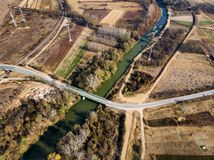 Countryside road and scenery aerial view. Countryside road and agriculture land scenery aerial view, path, landscape, above, farming, lane, empty, transportation stock image