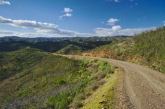 Countryside road around mountains Stock Photo