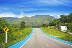 Countryside road with bicycle lane Stock Photo