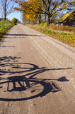 Countryside road  with bicycle shadow Stock Image
