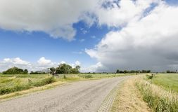 Countryside road and blue sky Royalty Free Stock Image