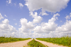 Countryside road and clouds Royalty Free Stock Photography