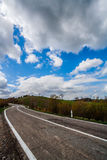 Countryside Road on a Cloudy Spring Day. Italy. A road in the countryside during a cloudy spring day in Italy Stock Photo