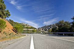 Countryside road in Despenaperros national park in Northern Anda. Road crossing Sierra Morrena Mountains of Despenaperros Natural Park, Los Organos geological Royalty Free Stock Photography