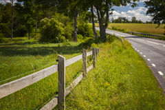 Countryside road fence. Image of wooden fence by countryside road stock image