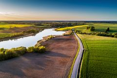 Countryside road through fields, aerial. Panorama of Lithuanian nature stock photo