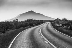 Free Countryside Road Leading To A Mountain Peak Royalty Free Stock Photo - 122815015