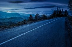 Countryside road through mountains at night. In full moon light. lovely autumnal scenery Stock Images