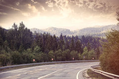 Countryside road in the mountains, Stock Images