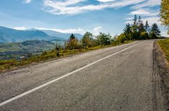 Countryside road through mountains. Winding countryside road through mountains. lovely autumnal scenery Royalty Free Stock Photos