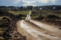 Countryside road after rain. Lithuania stock photos