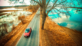 Countryside road and red car Stock Images