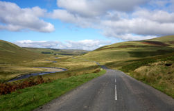 Countryside road and the river Elan in Wales. Royalty Free Stock Image