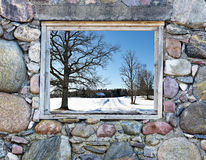 Countryside road seen through window of old building Stock Photos