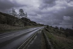Countryside road with stone walls aside in Peak District Nationa Stock Photo