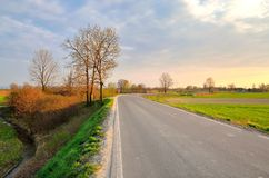 Countryside road at sunset. Royalty Free Stock Photos