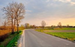 Countryside road at sunset. Royalty Free Stock Photo